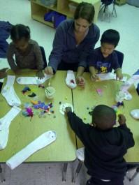 pre- school class making sock puppets